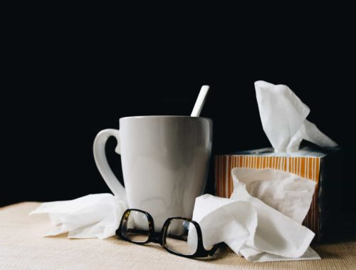 mug with glasses and tissues